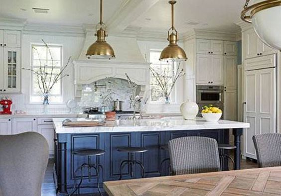 white kitchen navy island and gold accents
