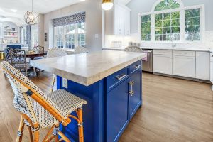 kitchen design with marble countertops, blue island, acrylic gold handles, custom window treatments, custom chairs