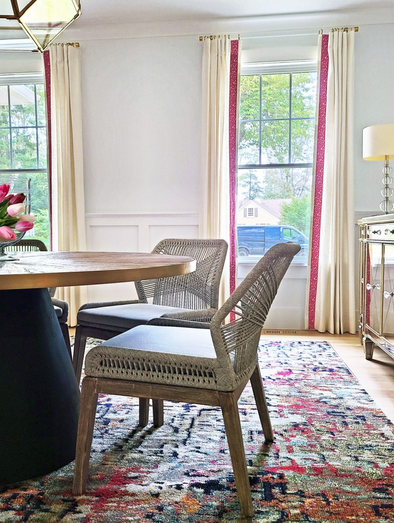 dining room design featuring window panels with animal print trim