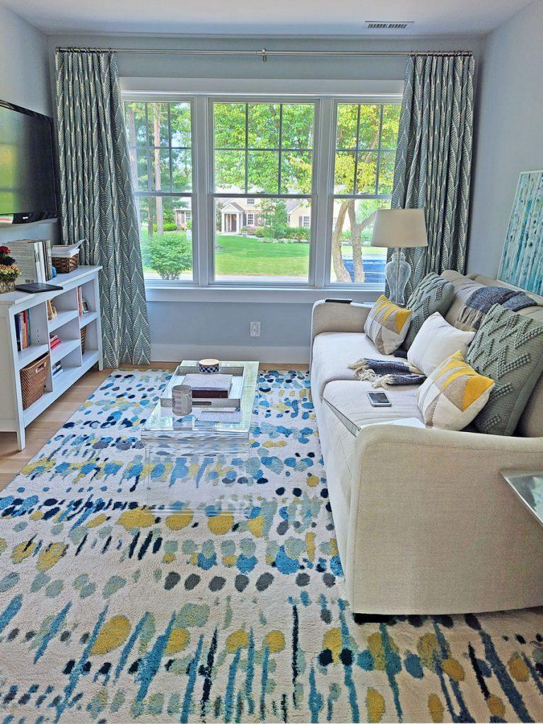 master bedroom sitting area featuring custom curtains